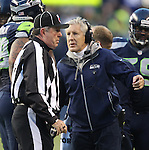 Seattle Seahawks Head Coach Pete Carroll, left, argues a call with Head linesman Jeff Rice during their game against the St. Louis Rams at CenturyLink Field in Seattle, Washington on December 30, 2012.   The Seahawks came from behind to beat the Rams 20-13.    © 2102.  Jim Bryant Photo. All Rights Reserved.