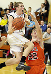 Black River's Carl Younglas puts up a shot against Buckeye's Nick Wilson during the third quarter. (RON SCHWANE / CT)