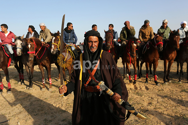 A Palestinian bedouin man wears traditional dress holds a sword during a rally marking the 41st anniversary of Land Day, in Deir el-Balah, Central Gaza Strip, on March 31, 2017.  Land Day marks the killing of six Arab Israelis during 1976 demonstrations against Israeli confiscations of Arab land. Photo by Ashraf Amra
