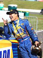 May 21, 2017; Topeka, KS, USA; NHRA funny car driver Ron Capps celebrates after winning his fourth straight victory following the Heartland Nationals at Heartland Park Topeka. Mandatory Credit: Mark J. Rebilas-USA TODAY Sports