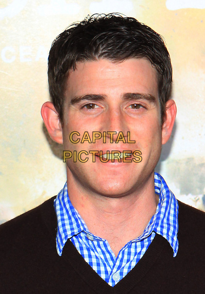 "BRYAN GREENBURG .Attending the Los Angeles Premiere of HBO's ""The Pacific"" held at Grauman's Chinese Theater, Hollywood, California, USA, 24th February 2010 .portrait headshot blue black v-neckl gingham mouth open .CAP/ADM/TC.©T. Conrad/AdMedia/Capital Pictures."