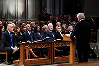 From left, President Donald Trump, first lady Melania Trump, former President Barack Obama, Michelle Obama, former President Bill Clinton, former Secretary of State Hillary Clinton, and former President Jimmy Carter listen as former Canadian Prime Minister Brian Mulroney speaks during a State Funeral at the National Cathedral, Wednesday, Dec. 5, 2018, in Washington, for former President George H.W. Bush.<br /> CAP/MPI/RS<br /> &copy;RS/MPI/Capital Pictures