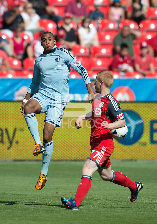 August 18, 2012: Sporting KC forward Teal Bunbury #9 and Toronto FC defender Richard Eckersley #27 in action during an MLS game between Toronto FC and Sporting Kansas City at BMO Field in Toronto, Ontario Canada..Sporting Kansas City won 1-0.