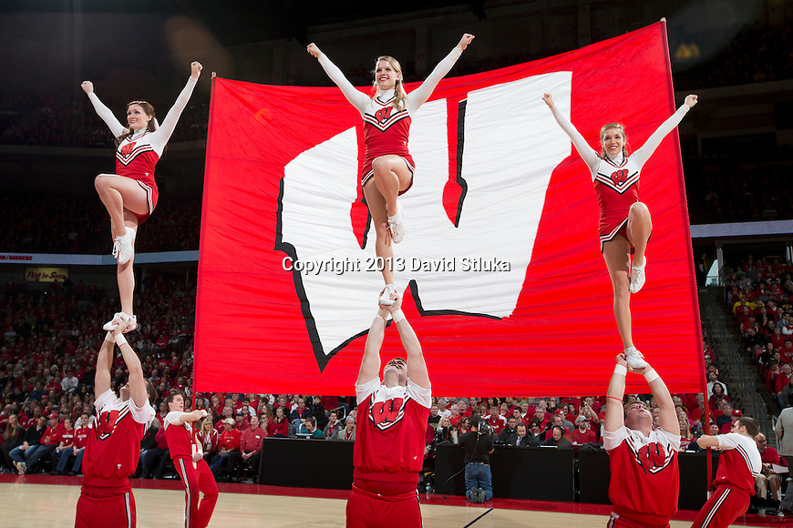 Wisconsin Badgers cheerleaders perform during a Big Ten Conference NCAA college basketball game against the Michigan Wolverines Saturday, February 9, 2013, in Madison, Wis. The Badgers won 65-62 (OT). (Photo by David Stluka)