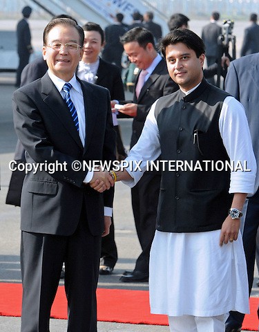 "CHINESE PREMIER WEN JIABAO VISITS INDIA.Wen Jiabao being met on arrival by the Minister of State for Commerce and Industry, Shri Jyotiraditya Scindia, Air Force Station Palam, New Delhi_15/11/2010.Photo Credit: ©Shivraj-Newspix International..**ALL FEES PAYABLE TO: ""NEWSPIX INTERNATIONAL""**..PHOTO CREDIT MANDATORY!!: NEWSPIX INTERNATIONAL..IMMEDIATE CONFIRMATION OF USAGE REQUIRED:.Newspix International, 31 Chinnery Hill, Bishop's Stortford, ENGLAND CM23 3PS.Tel:+441279 324672  ; Fax: +441279656877.Mobile:  0777568 1153.e-mail: info@newspixinternational.co.uk."
