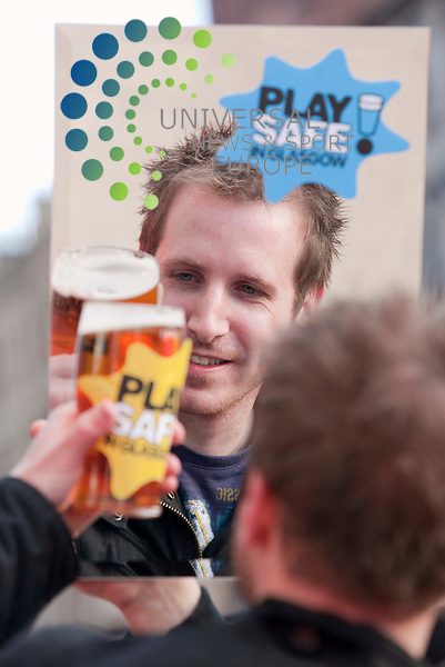 Play Safe campaign launched. Galaxy FM DJ Garry Spence promotes safety messages., over the coming festive season, reminding revelers to drink responsibly, and to enjoy the season without getting into serious trouble, the campaign includes taxi numbers, and small pocket mirrors to remind party goers to look at themselves, and see if they are drinking too much, the message is to have fun, but don,t risk serious harm and danger. Picture Johnny Mclauchlan/Universal News and Sport (Scotland)24/11/2010
