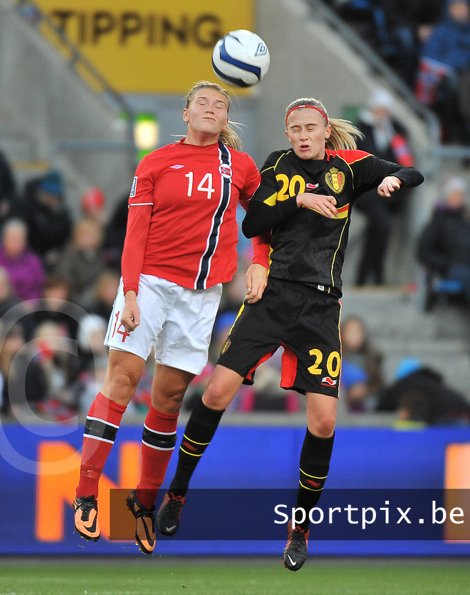 20130925 - OSLO , NORWAY : Belgian Julie Biesmans  pictured in a headerduel with Norwegian Ingvild Isaksen (14) during the female soccer match between Norway and Belgium , on the second matchday in group 5 of the UEFA qualifying round to the FIFA Women World Cup in Canada 2015 at the Ullevaal Stadion , Oslo . Wednesday 25th September 2013. PHOTO DAVID CATRY