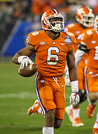 Charlotte, NC - December 2, 2017: Clemson Tigers linebacker Dorian O'Daniel (6) recovers a fumble during the ACC championship game between Miami and Clemson at Bank of America Stadium in Charlotte, NC.  (Photo by Elliott Brown/Media Images International) Clemson defeated Miami 38-3 for their third consecutive championship title.
