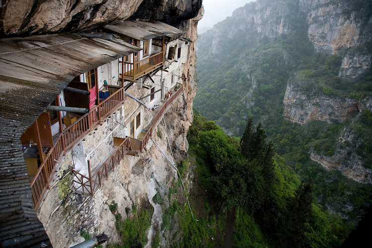 A rugged mountainous canyon conceals a still active Greek monastery which seems to somehow cling to the sheer cliffs.