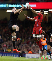 Pictured L-R: Brodie Retallick of New Zealand against Taulupe Faletau of Wales Saturday 22 November 2014<br />