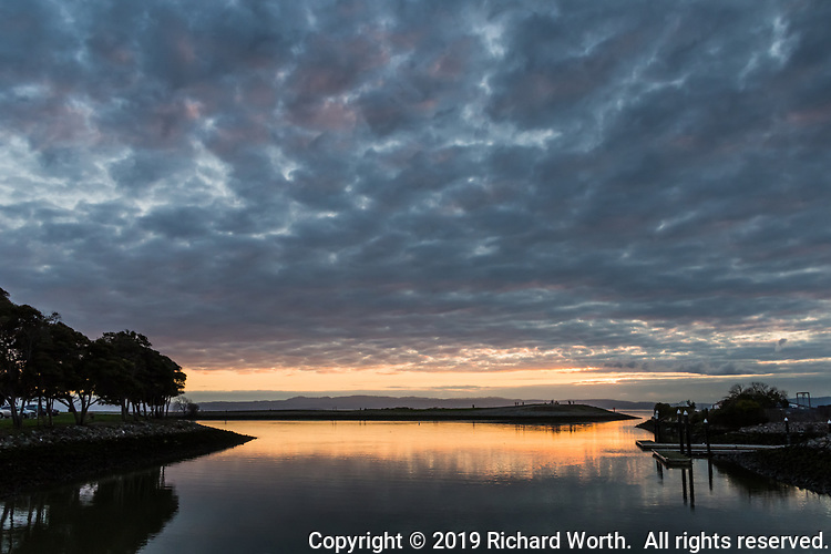 Instead of turning fiery, the sunset drifted into a quiet, muted mood along San Francisco Bay.