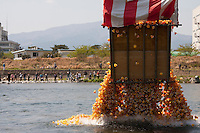 A box containing fifteen thousand rubber ducks is emptied in to the Sakawa River during the Ashigara River festival, Kintaro duck-race in Matsuda, Kanagawa, Japan April 25th 2010