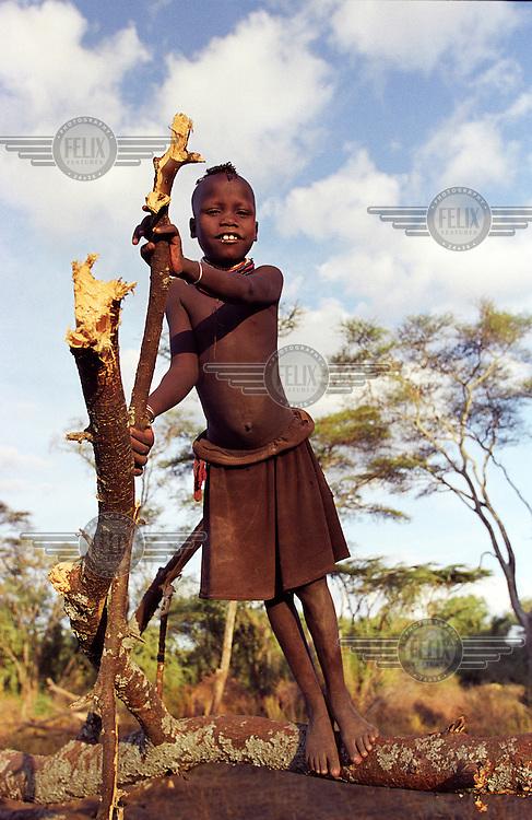 ©Crispin Hughes/Panos Pictures..KENYA Turkana  Nr Oropoi, Kakuma district...Turkana girl playing in a Turkana camp near the Ugandan border in Kakuma district..The Turkana are nomadic herders, one of a group of related Nilotic peoples, including  the Karimojong of Uganda and the Toposa of Sudan, who moved southwards into the region. ..