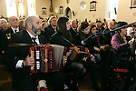 8-12-2014; Danny Healy-Rae and his children play some Irish music during Mass at the funeral of former South Kerry TD Jackie Healy-Rae in Kilgarvan, County Kerry on Monday.<br /> Picture by Don MacMonagle