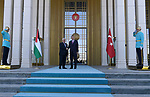 Turkish President Tayyip Erdogan and Palestinian President Mahmoud Abbas shake hands during a welcoming ceremony at the Presidential Palace in Ankara, Turkey, August 28, 2017. Photo by Osama Falah