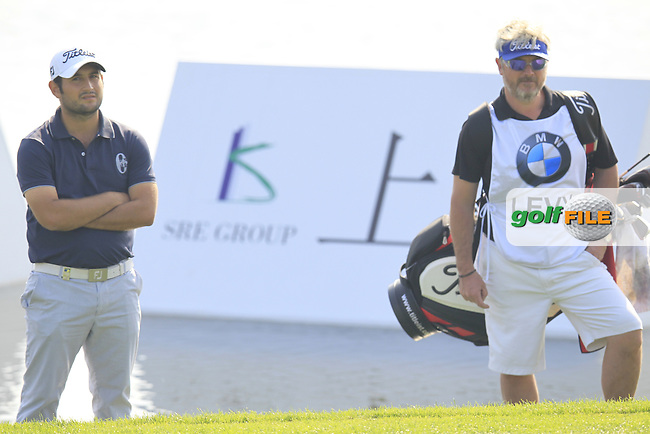 Alexander Levy (FRA) and caddy Bo at the 9th green during Sunday's Final Round of the 2014 BMW Masters held at Lake Malaren, Shanghai, China. 2nd November 2014.<br /> Picture: Eoin Clarke www.golffile.ie