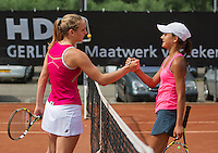 August 6, 2014, Netherlands, Rotterdam, TV Victoria, Tennis, National Junior Championships, NJK,  Merel Hoedt (NED) (r) congratulates Isolde de Jong with her victory<br /> Photo: Tennisimages/Henk Koster