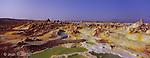 Sur une largeur de plusieurs centaines de metres,  le volcan du Dallol est coloré de teintes vives allant du rouge le plus intense au jaune le plus ardent en passant par toutes les nuances de blanc et de vert. Les fluides hydrothermaux cristallisent a la sortie, se refroidissent et forment des evaporites colorees de teintes vives au milieu de lacs de saumure dun vert profond..La dépression du Danakil offre les paysages les plus diaboliques de la planète, en perpétuelle mutation sous l'effet des forces telluriques. Vers le nord, on s'aventure entre les concrétions multicolores, les fumerolles et les geysers de soufre du Dallol. Ethiopie...Danakil désert.The Dallol craters are the Earth's lowest known subaerial volcanic vents. The most recent of these craters, Dallol, was formed during an eruption in 1926. Colorful hot brine springs and fumarolic deposits are found in the Dallol area.