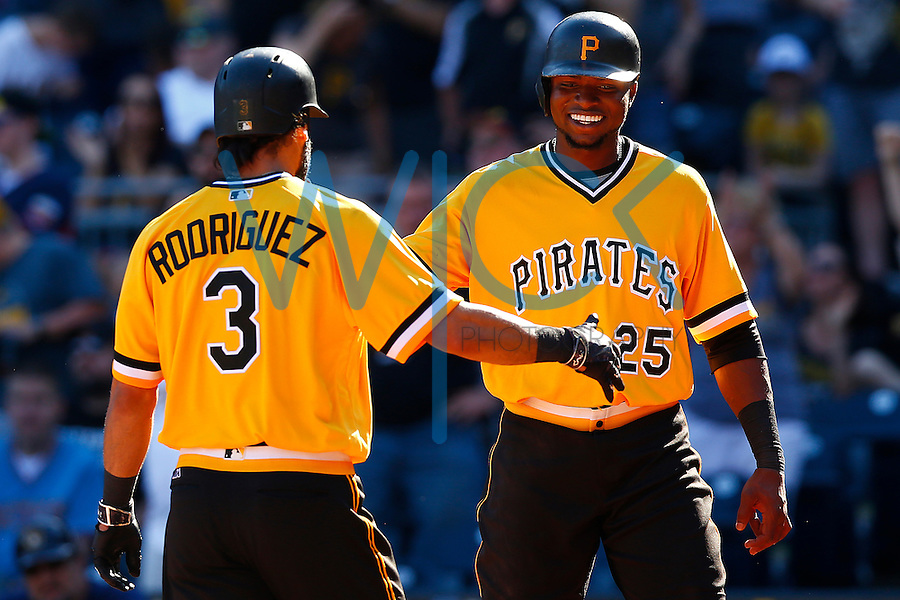 Gregory Polanco #25 of the Pittsburgh Pirates congratulates teammate Sean Rodriguez #3 of the Pittsburgh Pirates after hitting a solo home run against the Milwaukee Brewers during the game at PNC Park in Pittsburgh, Pennsylvania on April 17, 2016. (Photo by Jared Wickerham / DKPS)