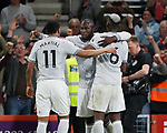 Second goal scorer Romelu Lukaku of Manchester United (c) celebrates with Anthony Martial oand supplier Paul Pogba of Manchester United during the premier league match at the Vitality Stadium, Bournemouth. Picture date 18th April 2018. Picture credit should read: David Klein/Sportimage
