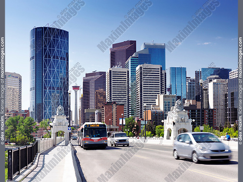 Calgary Transit bus and cars on Centre Street Bridge with Calgary city downtown skyline and Calgary tower in the background. Calgary, Alberta, Canada 2017.