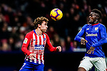 Antoine Griezmann of Atletico de Madrid in action as Inaki Williams Arthuer of Athletic de Bilbao looks on during the La Liga 2018-19 match between Atletico de Madrid and Athletic de Bilbao at Wanda Metropolitano, on November 10 2018 in Madrid, Spain. Photo by Diego Gouto / Power Sport Images