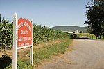 Nippenose Valley. Oriole Woodworking farm sign and lane.
