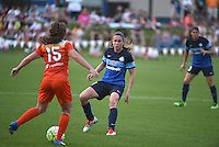 Kansas City, MO - Saturday May 07, 2016: FC Kansas City midfielder Heather O'Reilly (9) against Houston Dash defender Allysha Chapman (15) during a regular season National Women's Soccer League (NWSL) match at Swope Soccer Village. Houston won 2-1.