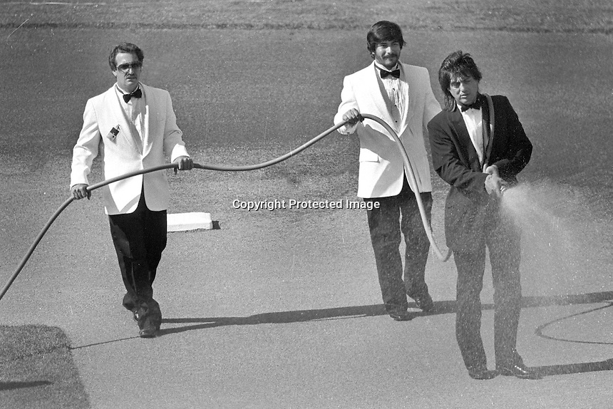 The Oakland Coliseum ground crew prepars the infield for the 1987 All-Star game to be played..wearing tuxedo's.(1987 photo/Ron Riesterer)
