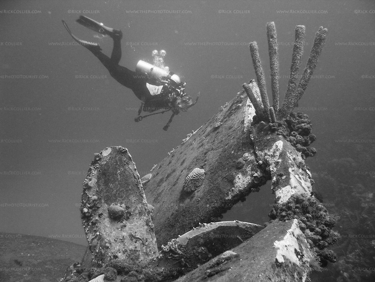 "Diving Bonaire, Netherland Antilles -- A diver swims past the propeller and rudder of the ""Hilma Hooker.""  (""Hilma Hooker"" dive site)."