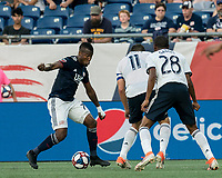 FOXBOROUGH, MA - JUNE 26: Cristian Penilla #70 dribbles during a game between Philadelphia Union and New England Revolution at Gillette Stadium on June 26, 2019 in Foxborough, Massachusetts.