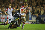 Ulster wing Andrew Trimble is tackled by Blues prop Campese Ma'afu..RaboDirect Pro12.Cardiff Blues v Ulster Rugby.Cardiff Arms Park.28.09.12.©Steve Pope