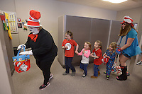 NWA Democrat-Gazette/BEN GOFF @NWABENGOFF<br /> Susie Bailey (left), secondary math teacher, leads a line of children through the building Thursday, March 3, 2017, during the Read Across America Day event at Arkansas Connections Academy in Bentonville. Local students and their families made crafts before gathering to listen to recording artist Kris Allen read 'Go, Dog. Go!' by P.D. Eastman over the school's LiveLesson remote learning technology. The tuition-free virtual public charter school serving kindergarten through 9th grade students statewide is currently in it's first school year.