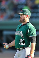 Left fielder Dylan Davis (11) of the Augusta GreenJackets warms up before a game against the Greenville Drive on Thursday, June 9, 2016, at Fluor Field at the West End in Greenville, South Carolina. Augusta won, 8-2. (Tom Priddy/Four Seam Images)