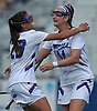 Becky Conto #14 of Hofstra University, right, gets congratulated by teammate Alex Mattera #23 after scoring a goal in the second half of a CAA women's lacrosse game against Towson at Shuart Stadium in Hempstead, NY on Sunday, April 16, 2017. Hofstra won by a score of 17-15.