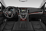 Stock photo of straight dashboard view of a 2015 Cadillac Escalade Premium 5 Door SUV 2WD Dashboard