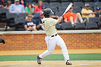 Joey Rodriguez (7) of the Wake Forest Demon Deacons follows through on his swing against the Virginia Cavaliers at Wake Forest Baseball Park on May 17, 2014 in Winston-Salem, North Carolina.  The Demon Deacons defeated the Cavaliers 4-3.  (Brian Westerholt/Four Seam Images)