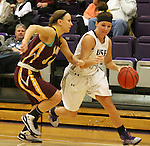 SIOUX FALLS, SD - JANUARY 30:  Jaicee Ulmer #14 from the University of Sioux Falls drives against Taylor Dillinger #34 from Minnesota Duluth Friday night at the Stewart Center. (Photo by Dave Eggen/Inertia)