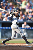Charleston RiverDogs right fielder Brandon Thomas #32 swings at a pitch during a game against the Asheville Tourists at McCormick Field July 26, 2014 in Asheville, North Carolina. The RiverDogs defeated the Tourists 8-7. (Tony Farlow/Four Seam Images)