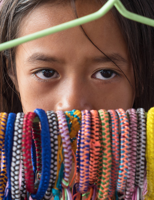 A young girl is selling colorful bangles in the street of Phnom Penh, Cambodia