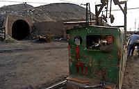 Coal mining worker outside the underground coal mine field in Wu Hai Xi, Inner Mongolia, China..