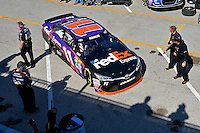 13-21 February, 2016, Daytona Beach, Florida USA<br /> As the shadows of fans atop the Sprint Fandeck fall across the pavement in the garage area the car of Denny Hamlin, FedEx Express Toyota Camry turns back into his garage stall.<br /> ©2016, F. Peirce Williams