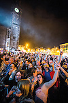 © Joel Goodman - 07973 332324 . 31 August 2013 . Rochdale , UK . The crowd cheers following the performance by headliners , The Feeling , as the town hall clock tower , illuminated by a remotely triggered flash , looms in the background . The Rochdale Feel Good Festival . Photo credit : Joel Goodman