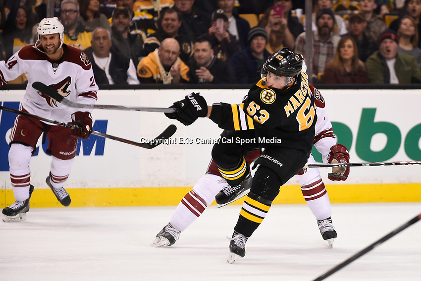 February 28, 2015 - Boston, Massachusetts, U.S. - Boston Bruins left wing Brad Marchand (63) takes his shot during the NHL match between the Arizona Coyotes and the Boston Bruins held at TD Garden in Boston Massachusetts. The Bruins defeated the Coyotes 4-1 in regulation time. Eric Canha/CSM