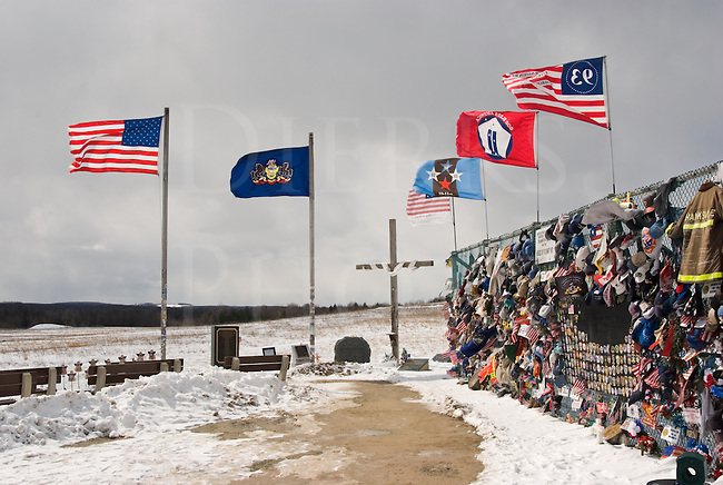 Picture of flags flying in the bitter cold winter wind at the Flight 93 Memorial crash site on 911, Shanksville, PA, USA.