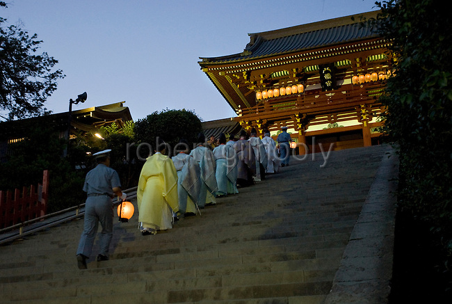 Following the collecting and distribution of seaweed during a purification ritual known as hamaorisai priests make their way to the main hall of Tsurugaoka Hachimangu shrine at the start of the 3-day Reitaisai festival in Kamakura, Japan on  14 Sept. 2012.  As a symbol of the purification, priests collect the seaweed from the sea and take it back to the shrine, hanging pieces around the shrine grounds to appease the gods. Photographer: Robert Gilhooly