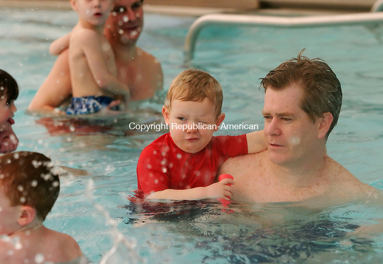 CHESHIRE, CT, 01/28/07- 012807BZ02- <br /> Conor Prendergast, 2, of Cheshire, closes an eye to avoid being splashed while swimming with his father, Rich Prendergast, at the Cheshire Community Pool as part of open house activities for St. Bridget's School in Cheshire Sunday.  Conor's older brother attends St. Bridget's School. <br /> Jamison C. Bazinet Republican-American