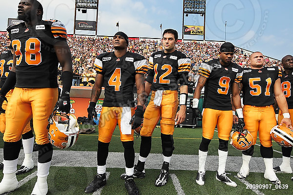 September 7, 2009; Hamilton, ON, CAN; Hamilton Tiger-Cats defensive end Montez Murphy (98) wide receiver Arland Bruce III (4) quarterback Quinton Porter (12) defensive back Geoff Tisdale (9) linebacker Jordan Matechuk (51). CFL football - the Labour Day Classic - Toronto Argonauts vs. Hamilton Tiger-Cats at Ivor Wynne Stadium. The Tiger-Cats defeated the Argos 34-15. Mandatory Credit: Ron Scheffler.