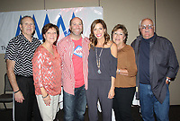 NWA Democrat-Gazette/CARIN SCHOPPMEYER Jim and Rhonda Woodruff (from left), Patrick and Meredith Woodruff and Peggy and Buddy Jordan welcome Miller McNeill Woodruff Foundation supporters to the sixth annual Cupcakes & Cocktails on March 31 at the Fayetteville Town Center.