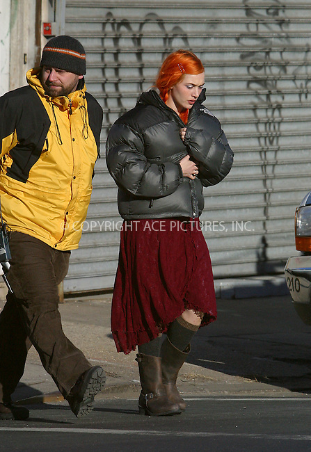"British actress Kate Winslet battles chilly wind as she walks to the set of ""Ethernal Sunshine of the Spotless Mind"" which is filming today in Brooklyn's New Bushwick. Tralers were located around busy intersection on Metropolitan Avenue and Kate kept her head turning just to avoid speeding cars. It appears that her hair is in better order today as Kete's sporting braids. Brooklyn, January 14, 2003. Please byline: Alecsey Boldeskul/NY Photo Press.   ..*PAY-PER-USE*      ....NY Photo Press:  ..phone (646) 267-6913;   ..e-mail: info@nyphotopress.com"